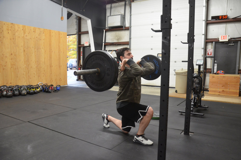 Stowe showing great positioning on his barbell lunges.