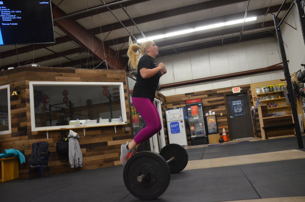 Kelly getting some air on her bar facing burpees.