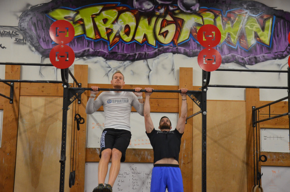 Tanner and Rob working through 25 Strict Pull-ups.