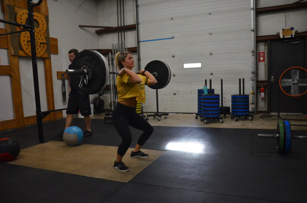 Maeve showing a good catch position on her Power Cleans.
