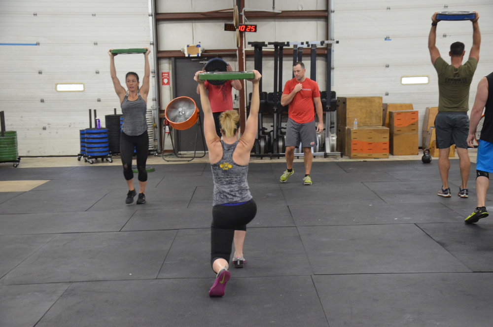 Stacy keeping her shoulders tight and engaged during Sunday's partner workout.