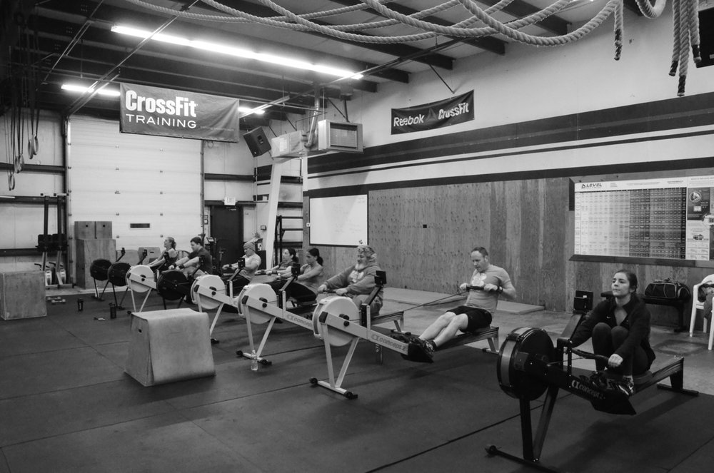 The 6 am class working through their 21 calorie row.