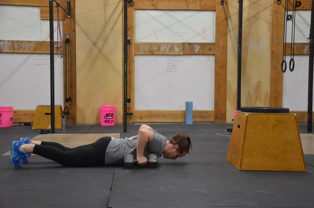 Courtney making sure to go chest to deck during her dumbbell burpee deadlifts.