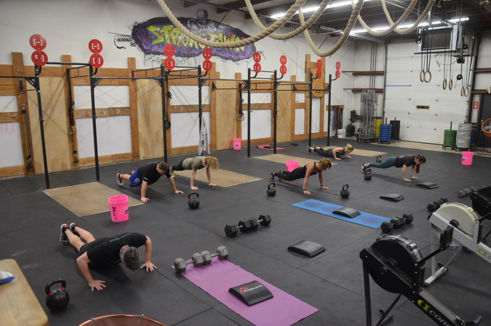 The 6am class working through their first minute of hand release push-ups.