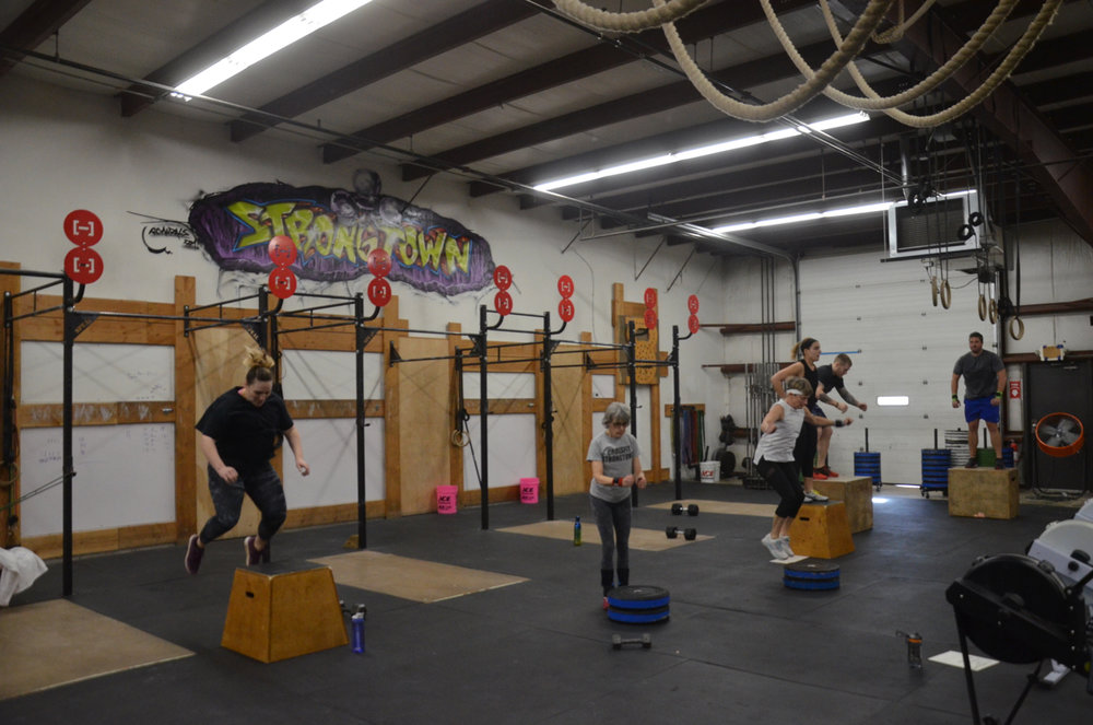 The 9:30 class working through their box jumps.