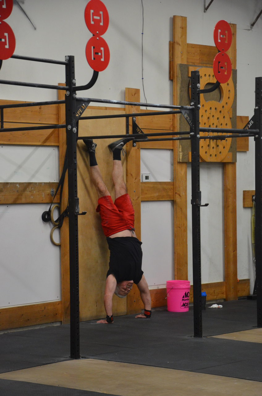Carl fighting through his 1 minute handstand hold.