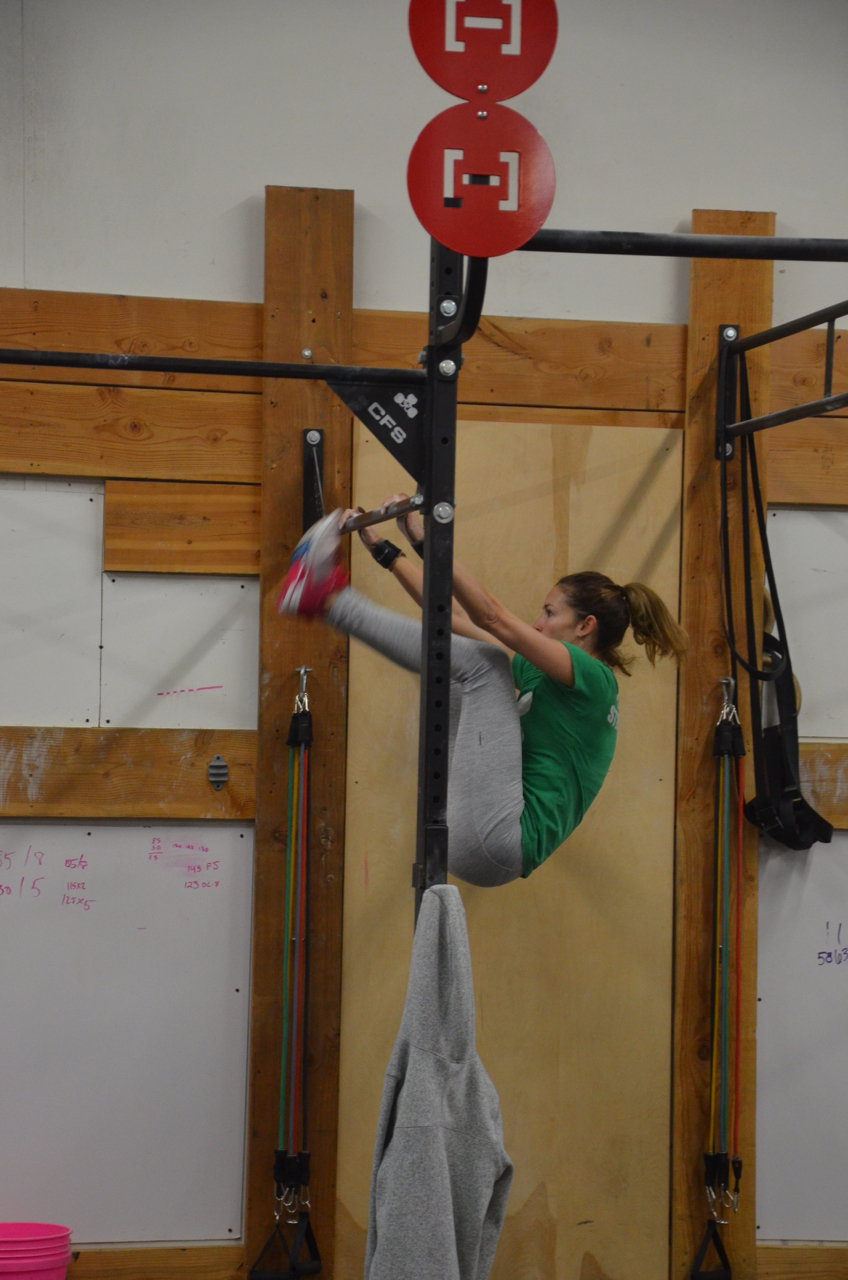 Danielle showing good form and standards on her toes to bar.