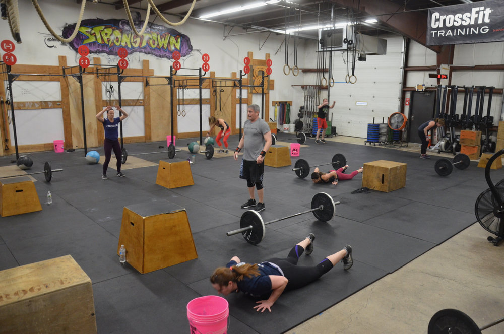 The 8am class grinding through 1 minute of burpees.