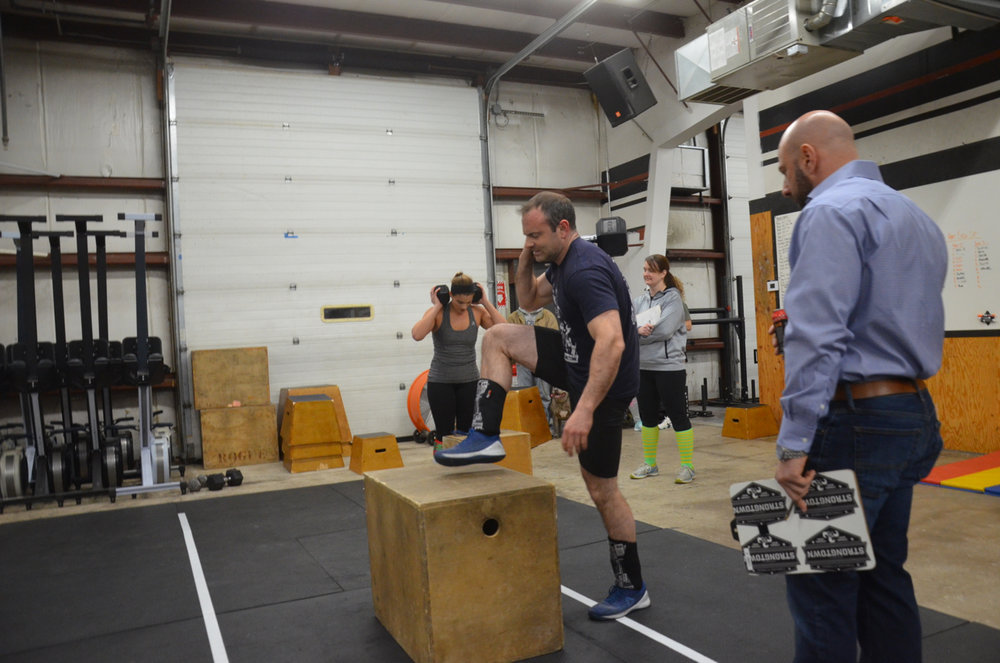Colin and Amanda working through their 50 dumbbell box step-ups.