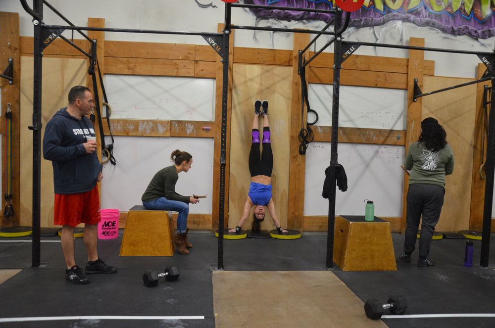 Jen looking strong on the strict handstand push-ups.