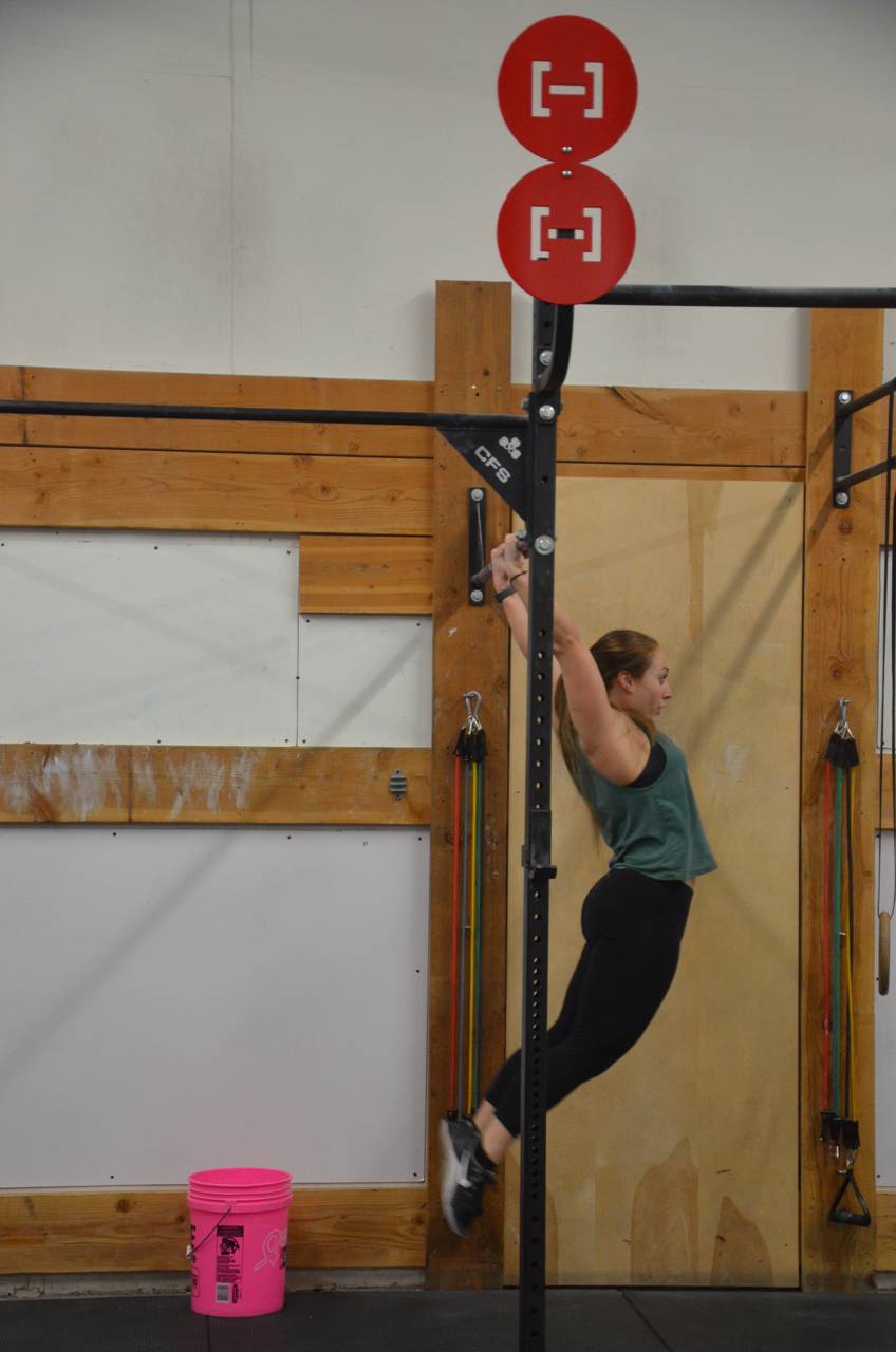 Kosky showing a nice arch position on her kipping pull-ups.