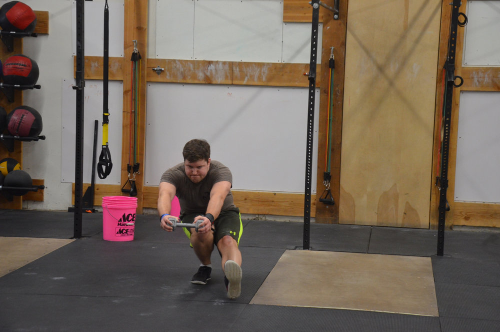 Justin using a dumbbell to help focus on his balance at the bottom of his pistol squat.