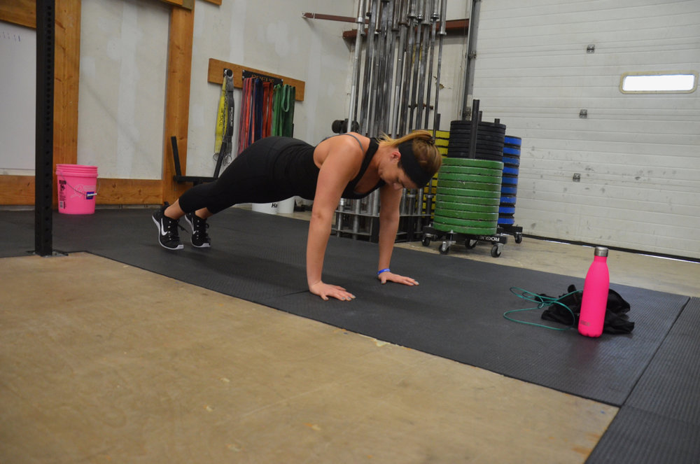 Amanda working on keeping a solid hollow position during her push-ups.