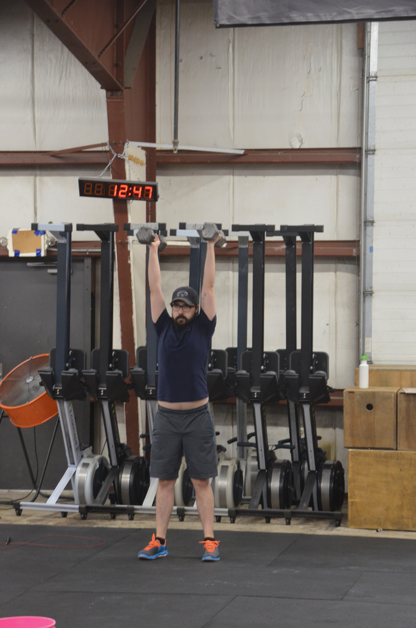 Mike showing a nice lockout on his dumbbell thrusters.