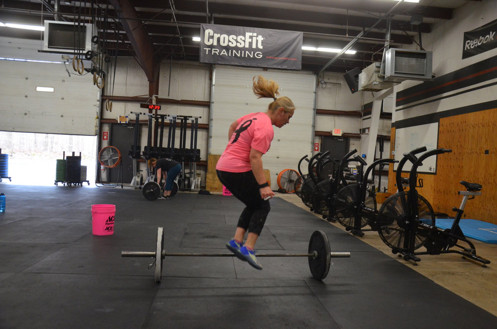 Dani mid air during her 40 lateral bar hops on Friday's workout.
