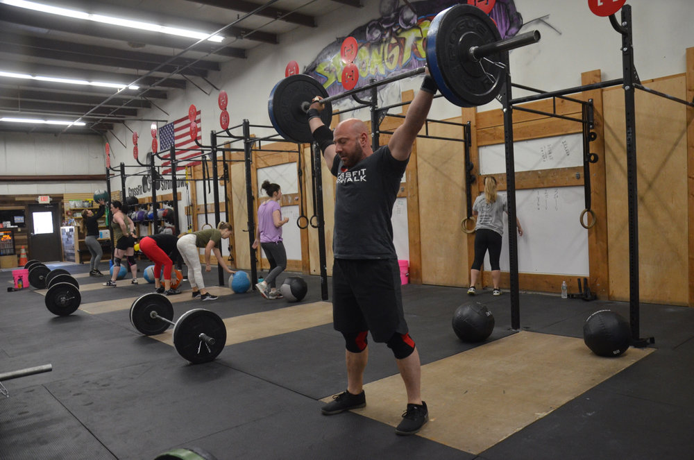 Glasser showing a nice lockout on his snatch.