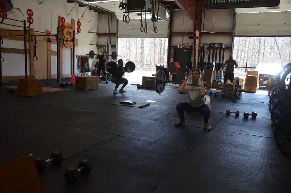 MB working through 1 minute of max front squats.