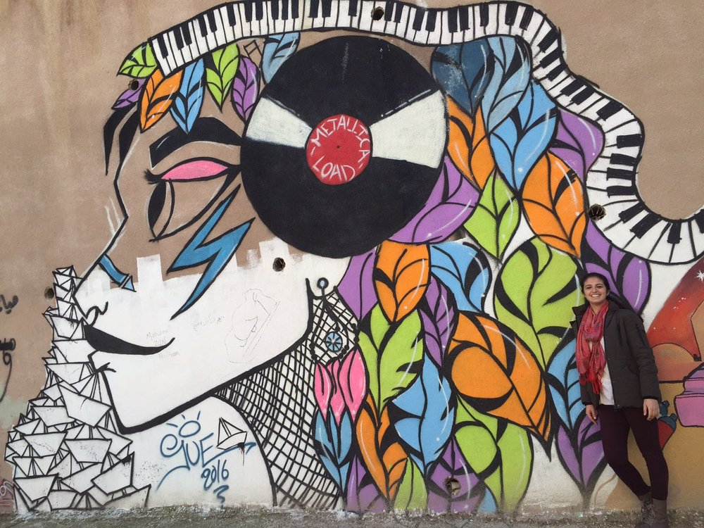 Urban Refuge team member Michelle Abou-Raad admiring street art in Amman, Jordan.