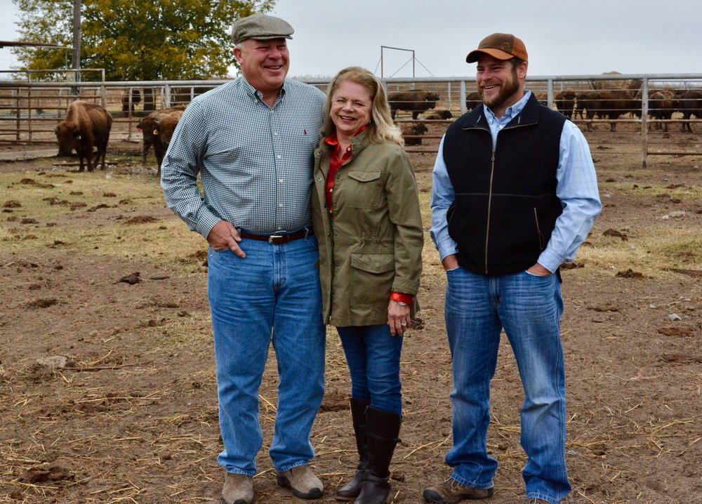 Nick and Linda Anderson with their son, Nicholas, on their bison ranch near Cushing.
