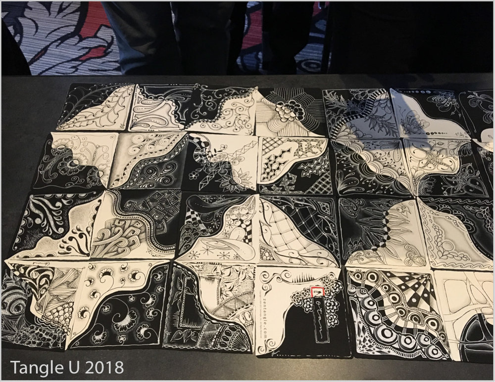 Mosaic of black and white reversed tile
