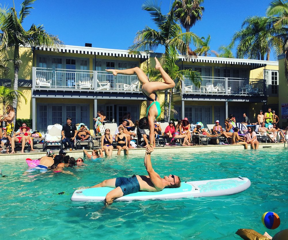 Dynamic duo and #couplesgoals Fallon Lev and Jordan Randall at the 2017 Yoga Pool Party.