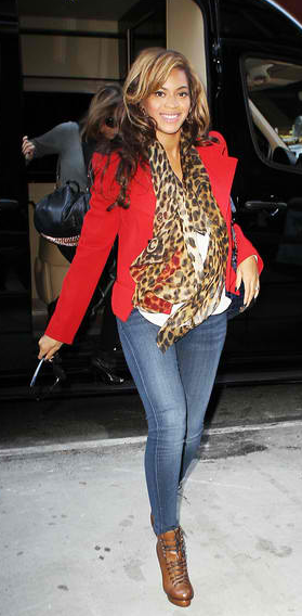 Beyonce is normally all about flaunting her curvaceous lower half, but here we see her in a long blouse,eye-catching blazer, and patterned scarf. The bright color and bold pattern draw our eye upward.The bootie creates length in her legs and the top hits just below the widest part of her hip (dollmaison.com).