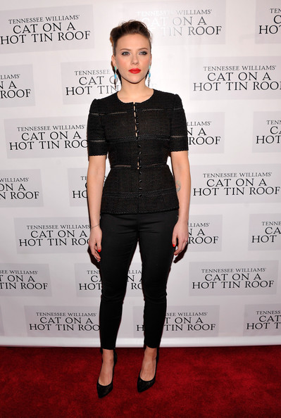 Scarlett Johansson uses head-to-toe black to her advantage. She styles a fitted blouse that cinches at the waist, showcasing her hourglass curves in a slimming way (stylebistro.com).