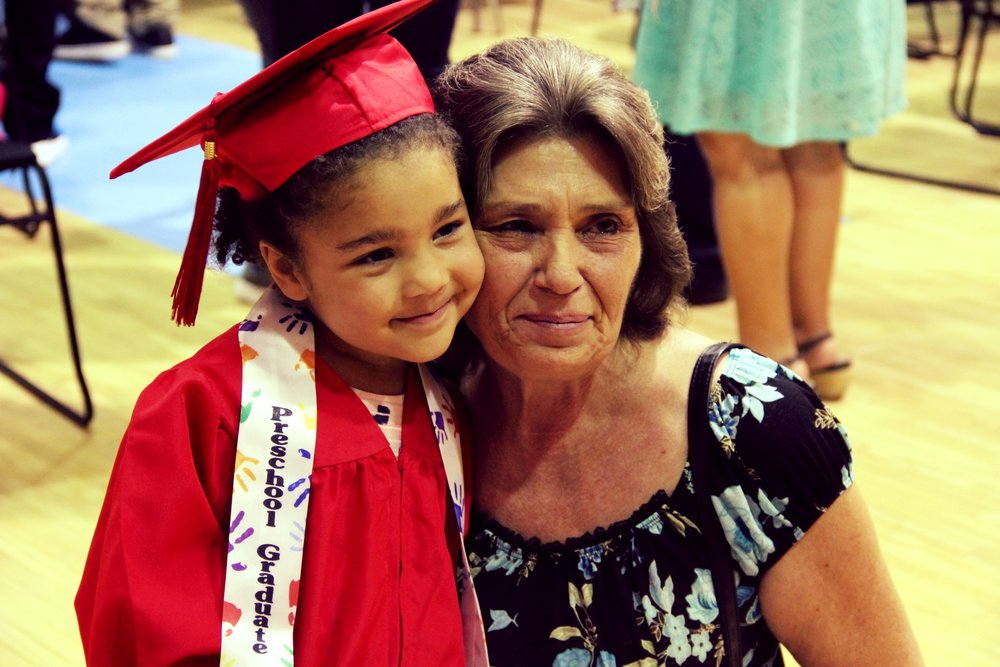 Lorrie and her grand daughter at preschool graduation