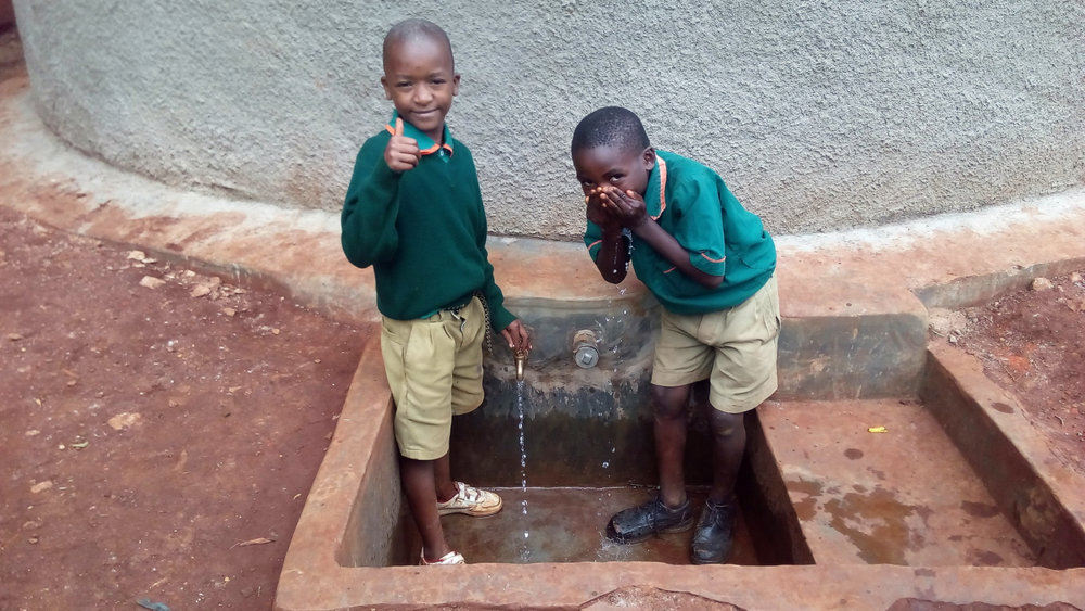 Kilingili Primary School students trying out the newly constructed well.