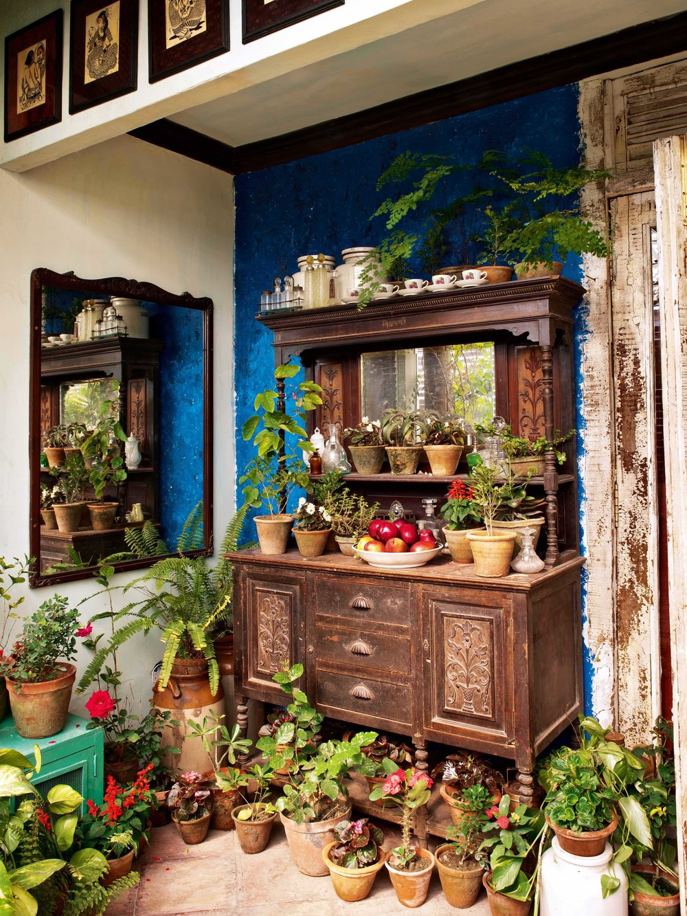 A 1960's dressing table surrounded by potted plants in the garden.