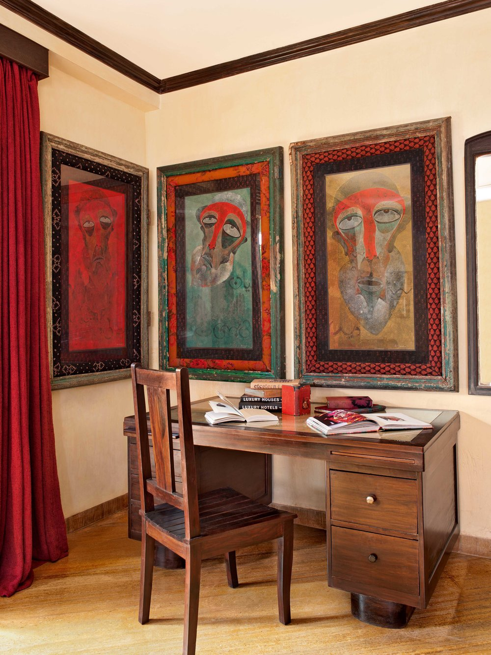 The walls of the otherwise functional study-cum-bedroom are adorned with art. A partner's desk from Russel Exchange in Kolkata is paired with a chair from Mukherjee's paternal home.