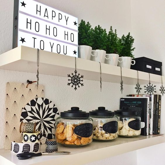 |2| Cute Kitchen Deco   Add funny Christmas quotes around your kitchen and mix them with green plants. Don't forget a jar of cookies, for when Santa comes.
