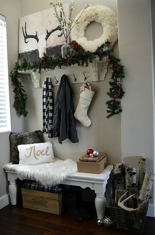 |3| Cosy Entryway   Begin with the door and entryway when you start decorating, it will set a holiday mood for your whole house. Add printed pillows, a cozy blanket, a furry rug and transform this space into a modern North Pole.