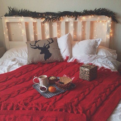 |7| Thematic Bedroom   Make your bedroom cozy by adding a cute knitted blanket and lights around your bed. Add also themed printed pillows and some fir branches.