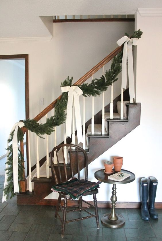 |9| Fir Branches and Bows   Even if it's just small detailing, by draping fir branches and bows along your staircase. Making your whole interior look really cozy.