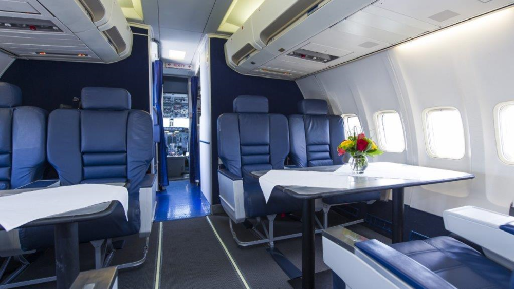 LEATHER BUSINESS CLASS SEATS WITH EXECUTIVE TABLES