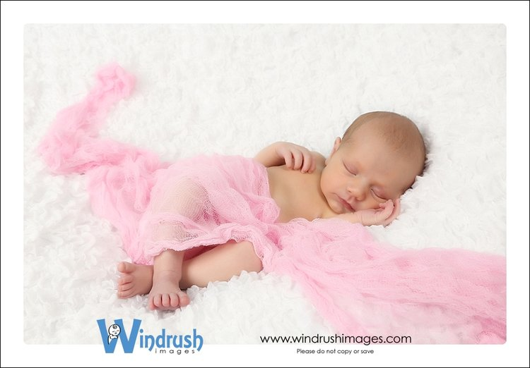 I always love when i can use some of my headbands and pink girly props to see more newborn photography please visit my website at www windrushimages com