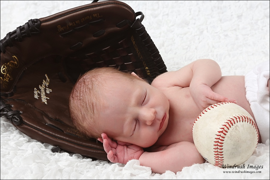 Newborn baby with baseball and glove taken by Calgary newborn photographer