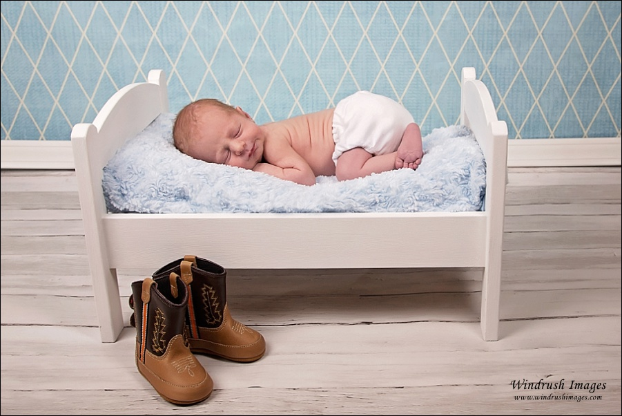 Western newborn image in Calgary with cowboy boots for Calgary Stampede