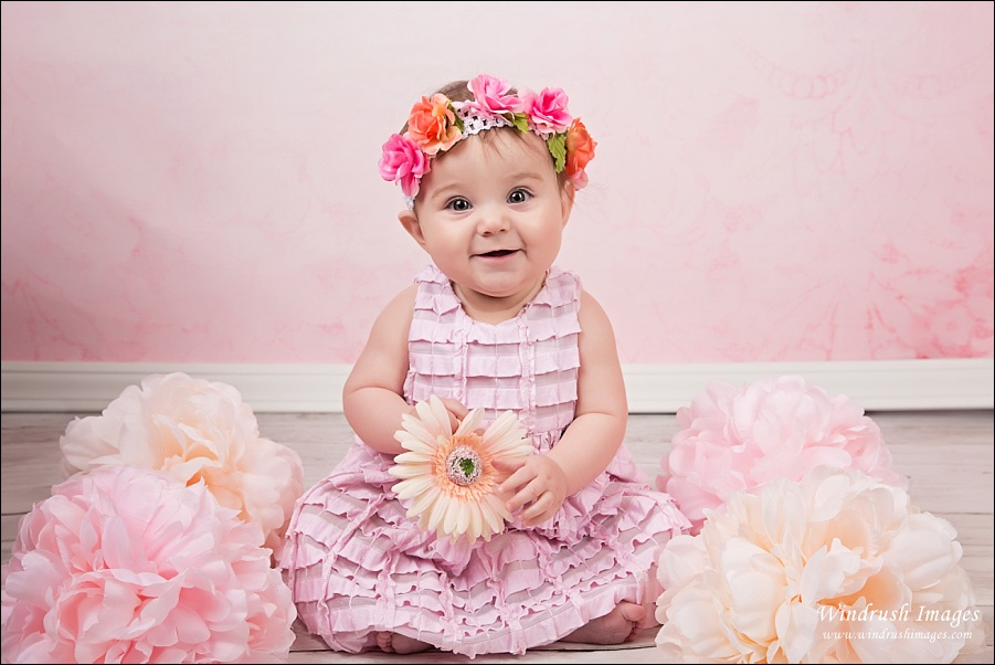 Sitting baby session by Calgary pghotographer 6 month old baby in pink flowers