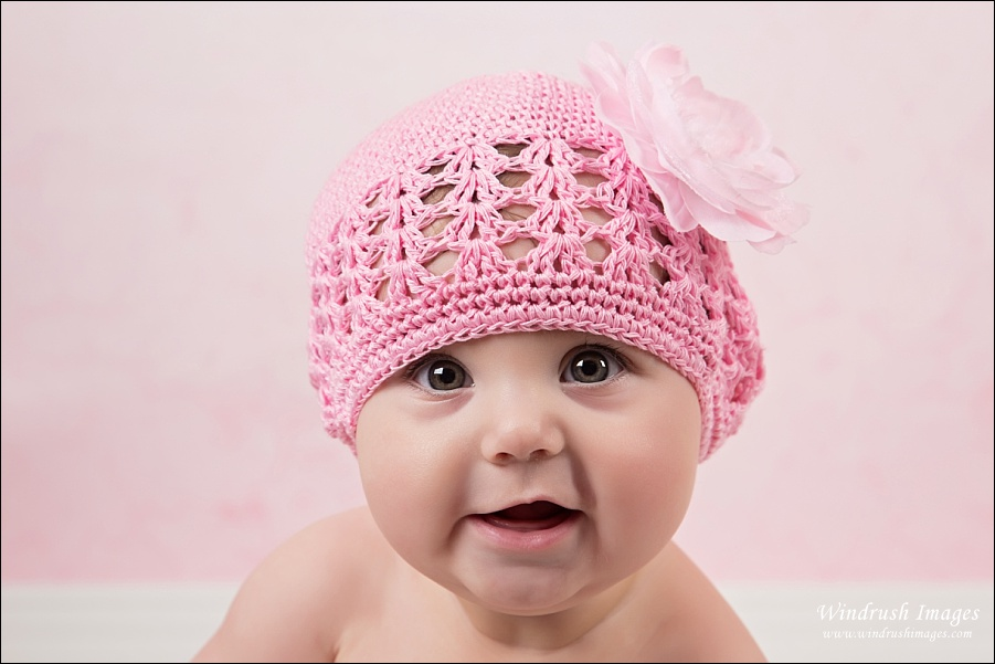 Calgary baby photography with pink flower hat