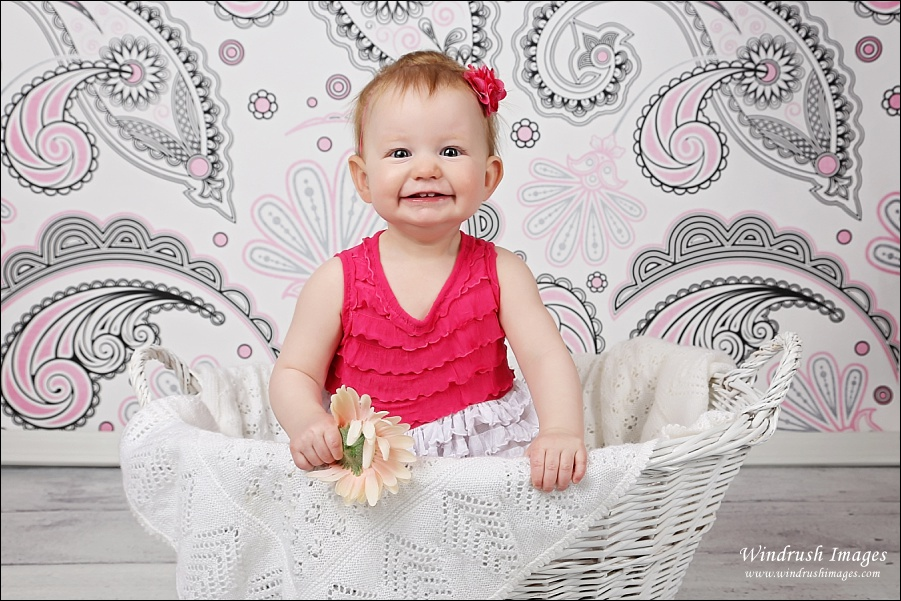 One year old photography session in Calgary in studio with pink background