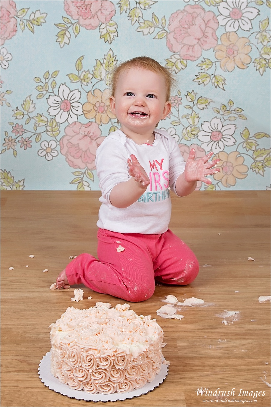 Little girl enjoying cake smash in Calgary Alberta photo studio
