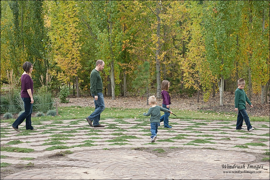 Family photograph of family walking around the labyrinth at Silver Springs Botanical Gardens in Calgary