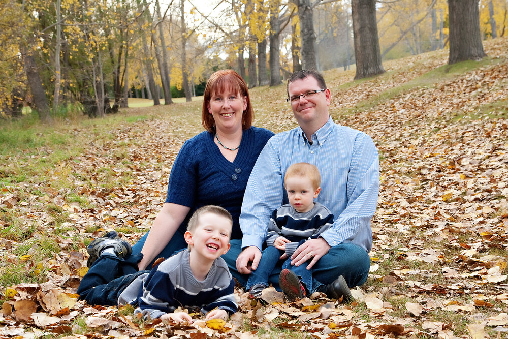 Family photo shoot in the Fall leaves at Confederation Park in Calgary