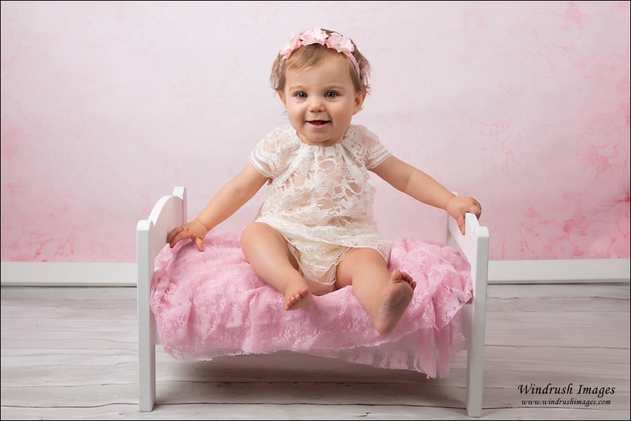 One-year-old-photography-with-pink-background-and-lace-dress-calgary-milestone-photography