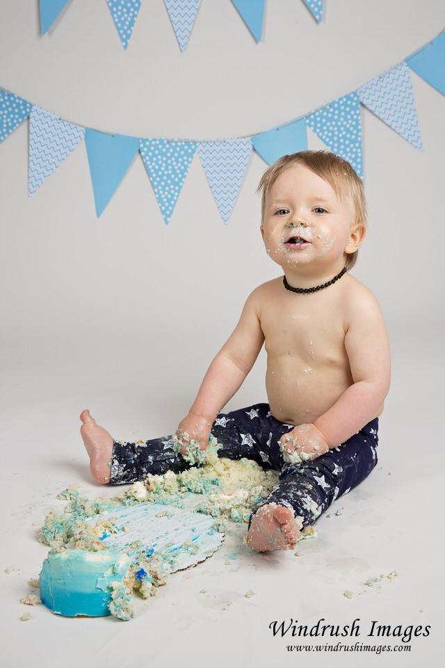 Baby-boy-finished-with-destroyed-cake-photographed-by-Calgary-cake-smash-photographer