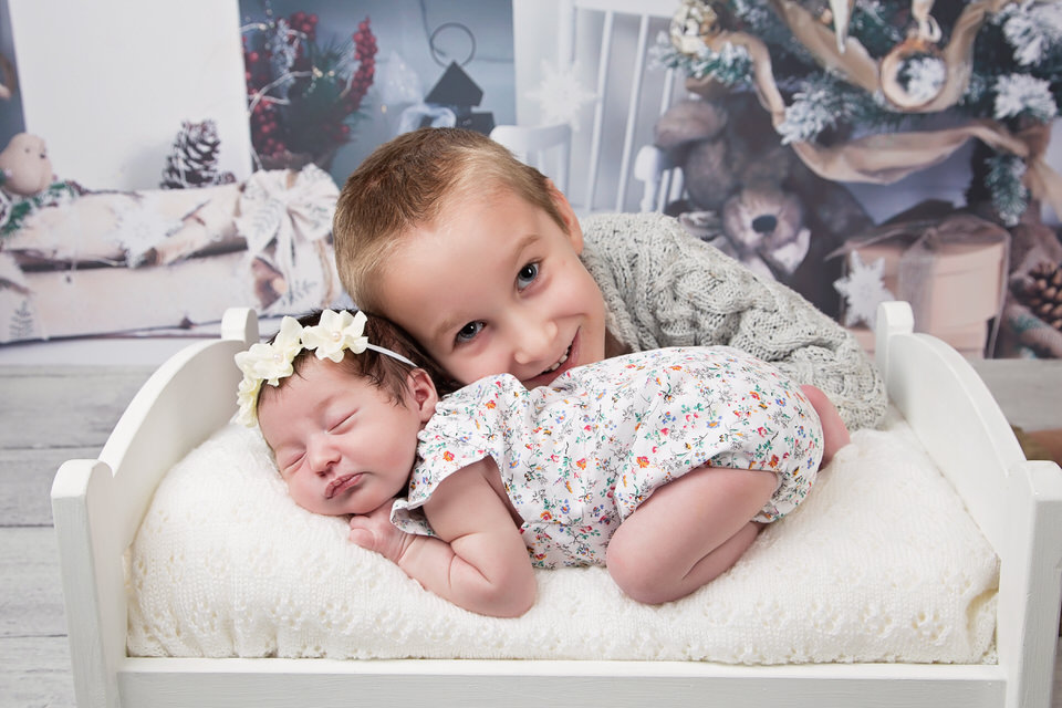 Christmas-newborn-photo-of-baby-and-brother-photographed-in-Calgary-photo-studio.jpg