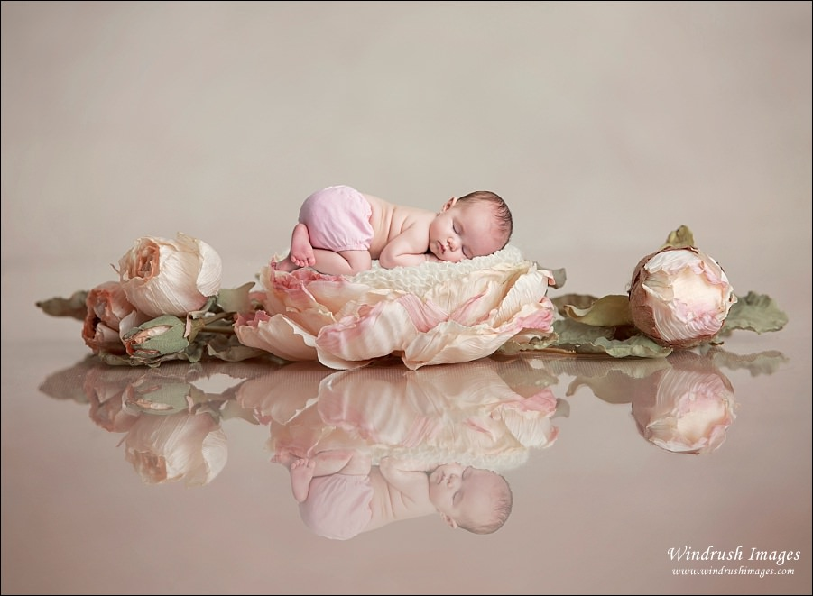 baby-girl-sleeping-on-flower-bed-with-reflection-Calgary-newborn-photography.jpg