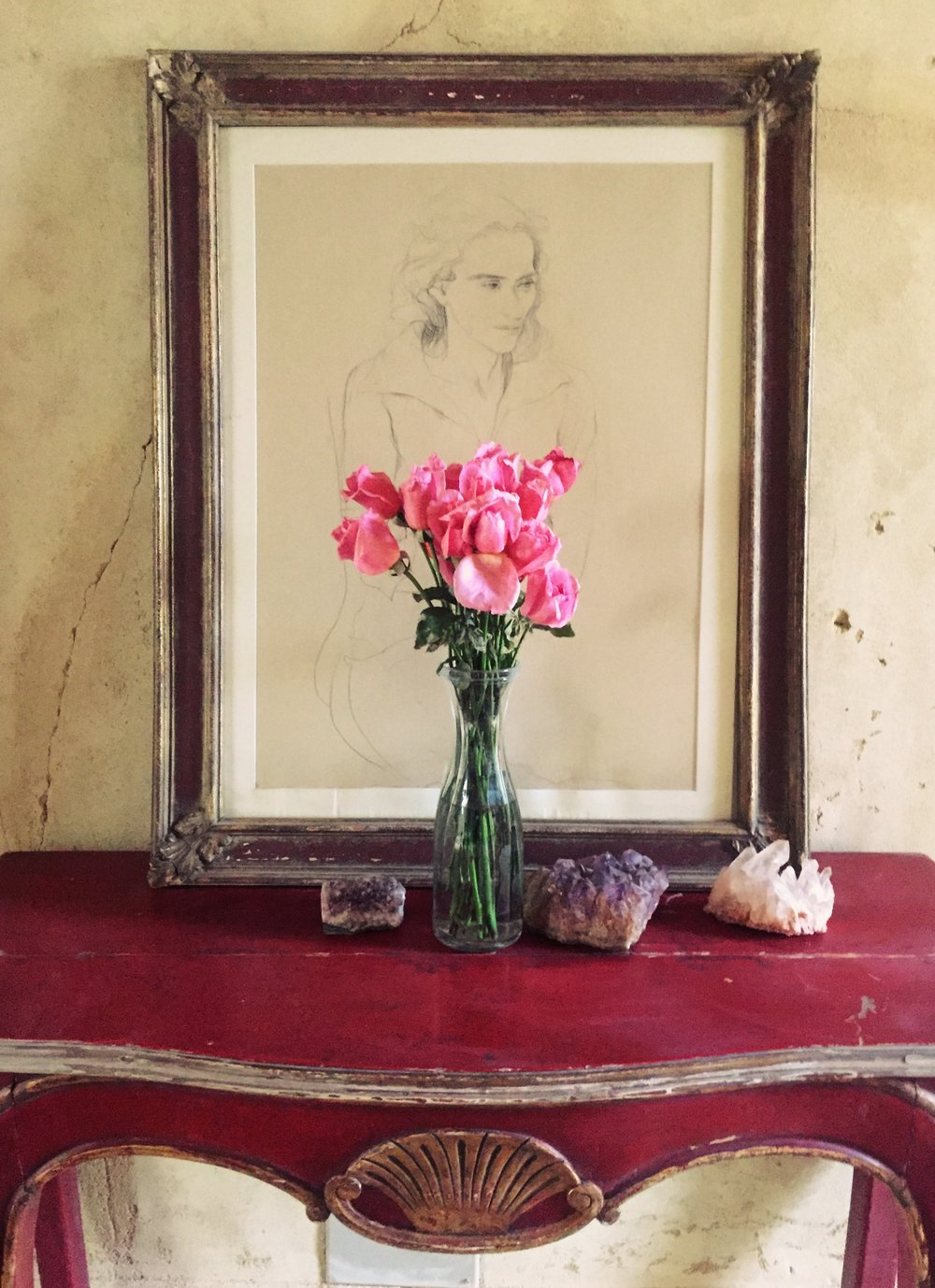 A drawing in the foyer of the house, Quartz and Amysthst crystals on the table and roses from Cairo.